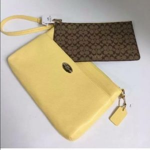 YELLOW COACH CLUTCH WITH SMALL POUCH INCLUDED